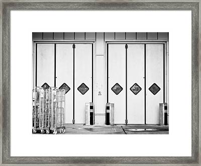 Warehouse Doors Framed Print by Tom Gowanlock