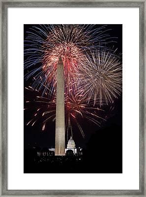 Washington Monument And U.s.capitol Under Fireworks Framed Print