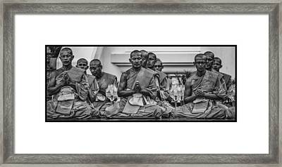 Wat Dhamma Monks Prayers Framed Print by David Longstreath