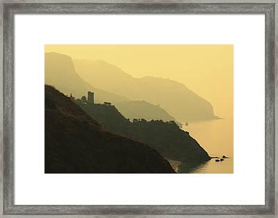 Watch Towers On The Marocerro Gordo Cliffs Framed Print by Ken Welsh