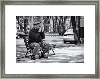 Watching Life Pass Framed Print by Pablo Lopez