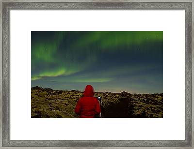 Watching The Northern Lights Framed Print by Andres Leon