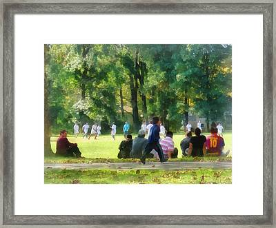 Watching The Soccer Game Framed Print by Susan Savad