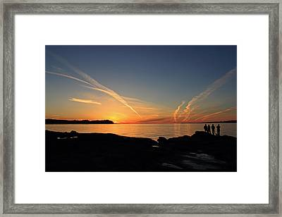 Watching The Sun Go Down Framed Print by Randy Hall