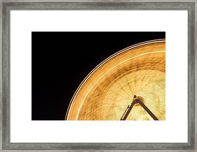 Watching The Wheel Go Round Framed Print by Heidi Smith