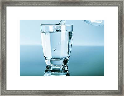 Water Being Poured Into A Glass Framed Print by Wladimir Bulgar