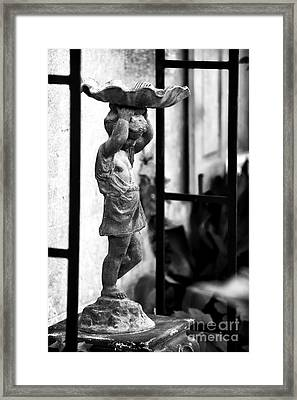 Water Carrier In The Garden Framed Print by John Rizzuto
