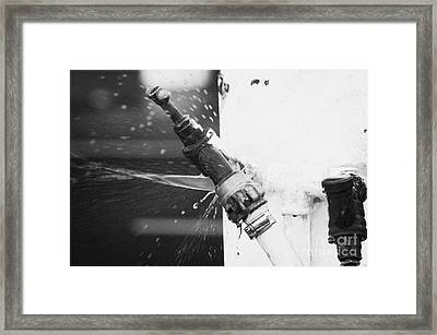Water Escaping From A Loose Fitting Hose And Tap On Orange Post Kilkeel Harbour County Down Northern Ireland Framed Print by Joe Fox