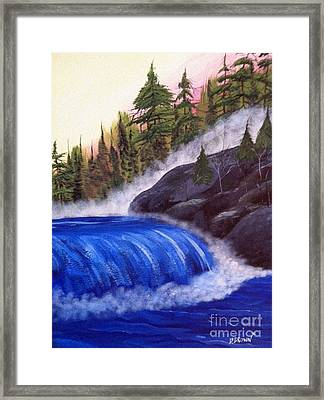 Water Fall By Rocks Framed Print