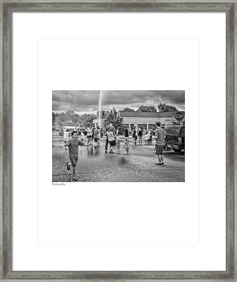 Water Fight Framed Print by David Coats