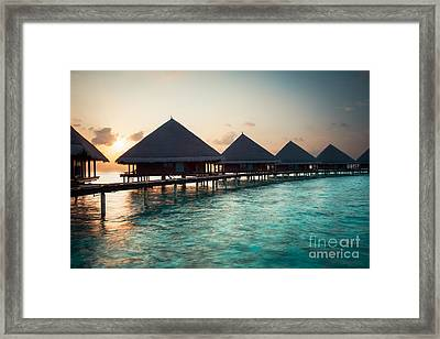 Waterbungalows At Sunset Framed Print by Hannes Cmarits