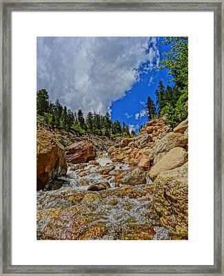 Waterfall In The Rockies Framed Print by Dan Sproul