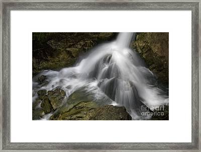 Waterfall In The Rocks Framed Print by Jaroslaw Blaminsky