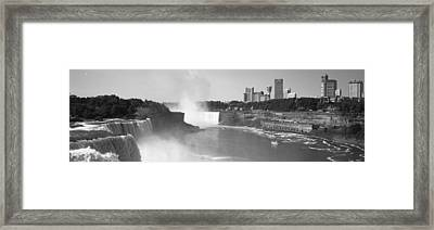 Waterfall With City Skyline Framed Print