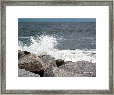 Wave Breaks On Rocks Framed Print by Tammy Wallace