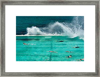Waves Breaking Over Edge Of Pool Framed Print by Panoramic Images