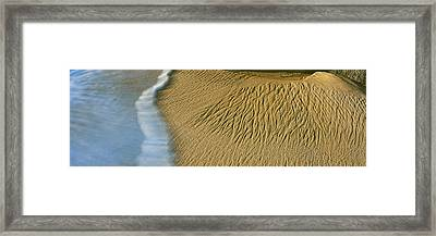 Waves Leave Intricate Sand Patterns Framed Print