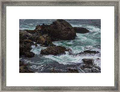 Waves Meet Rock Framed Print