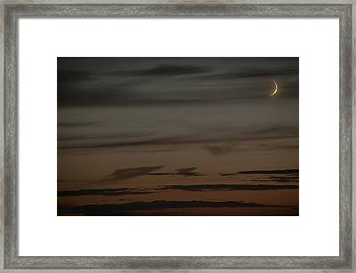 Waxing Crescent Moon Over Purple And Orange Evening Sky Framed Print