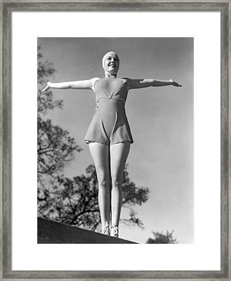 Wearing A Rubber Bathing Suit Framed Print by Underwood Archives