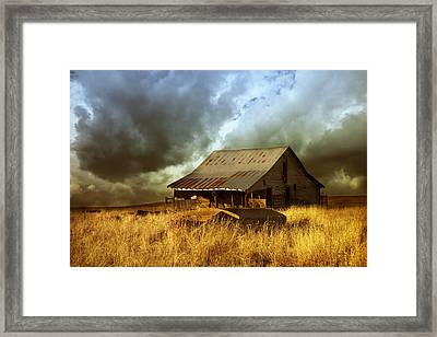 Weathered Barn  Stormy Sky Framed Print by Ann Powell