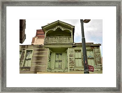 Framed Print featuring the photograph Weathered Old Green Wooden House by Imran Ahmed
