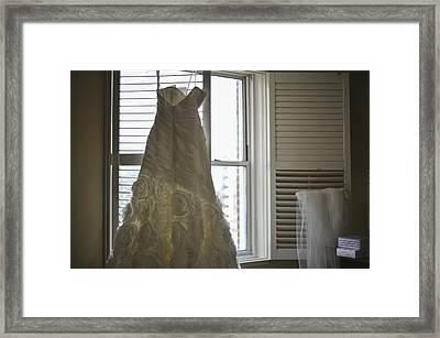 Wedding Dress And Veil By The Window Framed Print by Mike Hope