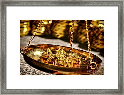 Weighing Gold Framed Print