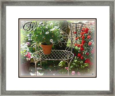 Framed Print featuring the photograph Welcome Flowers by Heidi Manly