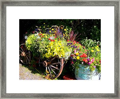 Framed Print featuring the photograph Welcome Wagon by Kathy Bassett