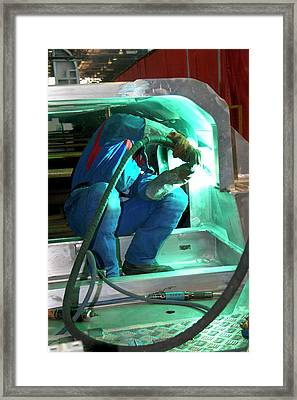 Welding In Train Construction Framed Print by Andrew Wheeler