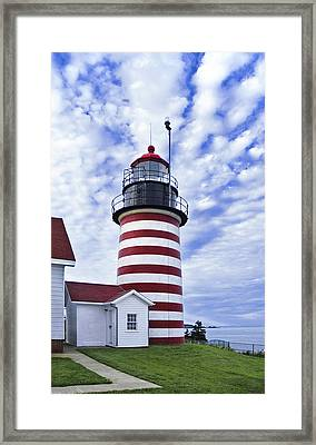 West Quoddy Head Lighthouse And Clouds Framed Print by Marty Saccone