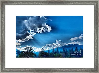 Westerly Clouds Framed Print by Julia Hassett