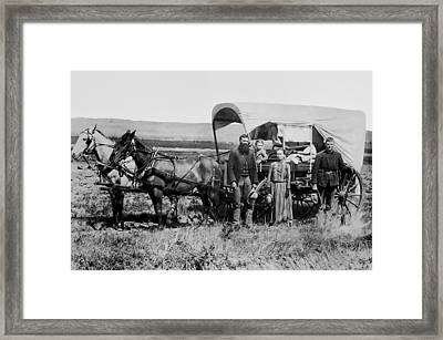Westward Family In Covered Wagon C. 1886 Framed Print by Daniel Hagerman