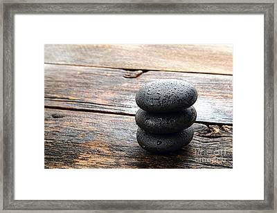 Wet Black Stones Framed Print