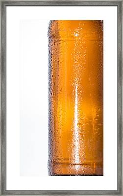 Wet Bottle Of Beer On White Framed Print by Handmade Pictures