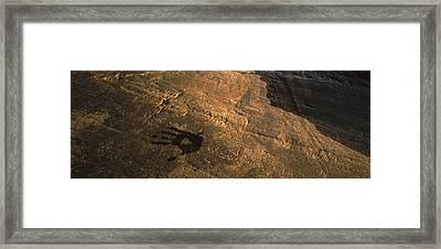 Wet Hand Print On Smooth Rock Near Lake Framed Print
