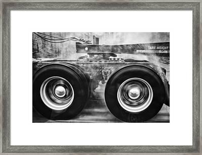 Wet Wheels Framed Print