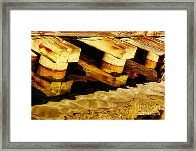 Wharf Reflections In Brown Framed Print by Nikolyn McDonald