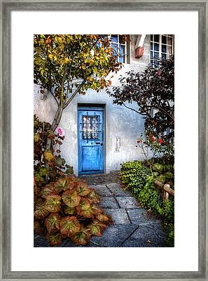 What's Behind The Blue Door   Basel Framed Print