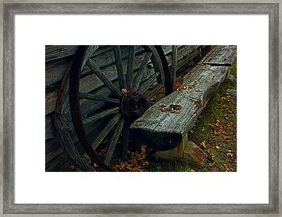 Wheel And Bench Framed Print by Mike Flynn