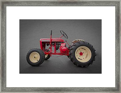 Wheel Horse Framed Print by Debra and Dave Vanderlaan