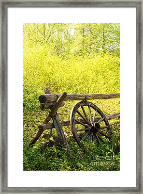 Wheel On Fence Framed Print