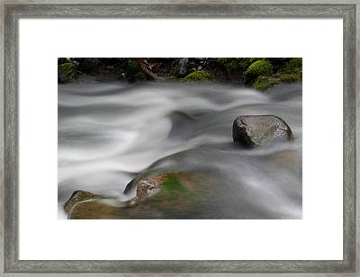 Where Little Day Dreams Slide Over Rocks Framed Print by Jeff Swan