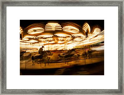 Whirling Carousel With Rider Framed Print by Aaron Baker