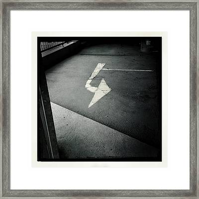 White Arrow On Dark Asphalt Framed Print