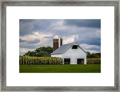 White Barn And Silo With Storm Clouds Framed Print