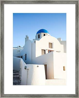 White Buildings And Blue Church In Oia Santorini Greece Framed Print by Matteo Colombo