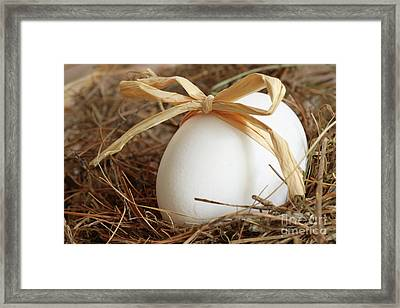 White Egg With Bow On Straw  Framed Print by Sandra Cunningham