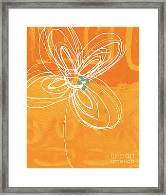 White Flower On Orange Framed Print by Linda Woods